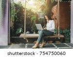 hipster asian woman relaxing... | Shutterstock . vector #754750060