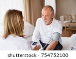 health visitor and a senior man ... | Shutterstock . vector #754752100