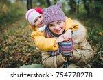 the younger sister hugs her... | Shutterstock . vector #754778278
