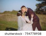 beautiful newlyweds walking in...   Shutterstock . vector #754778938