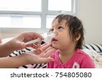 asian baby saline nasal wash | Shutterstock . vector #754805080