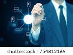 man sketching computer network | Shutterstock . vector #754812169