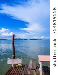 Small photo of Small wooden pier at fisherman village Koh Lanta City, Koh Lanta old town on clear sky day
