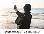 woman in hijab taking picture...   Shutterstock . vector #754837810