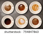 cup of coffee on wall background | Shutterstock . vector #754847863