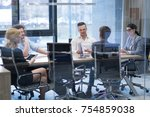 group of a young business... | Shutterstock . vector #754859038