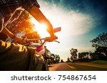 biker rides motorcycle on an... | Shutterstock . vector #754867654