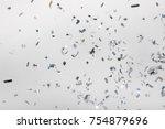 falling silver confetti pieces... | Shutterstock . vector #754879696