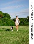 pregnant woman enjoying summer... | Shutterstock . vector #754879774