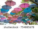 colorful umbrella decorate in... | Shutterstock . vector #754885678