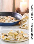 Small photo of Hake with clams, eggs and parsley