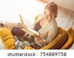 smiling happy woman reading...   Shutterstock . vector #754889758