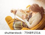 reading in sunny library. young ... | Shutterstock . vector #754891516