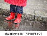 little boy in red rain clothes... | Shutterstock . vector #754896604