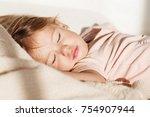 sleeping little girl. carefree... | Shutterstock . vector #754907944