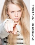 Small photo of Girl pointing finger to accuse someone