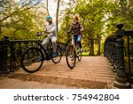 happy young people riding bikes ... | Shutterstock . vector #754942804