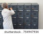 factory worker opening locker | Shutterstock . vector #754947934