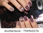 women's hands with a stylish... | Shutterstock . vector #754963276