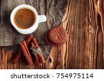 coffee cup and cookie on wood | Shutterstock . vector #754975114
