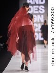 Small photo of A model walks the runway on the HSE ART&DESIGN catwalk. Fall/Winter 2016-17. MERCEDES-BENZ FASHION WEEK RUSSIA. 15 March 2016, Moscow, Russia.