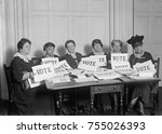 Small photo of National League of Women Voters hold up signs reading, 'VOTE', Sept. 17, 1924. Millions of women voted in 1920 and 1924, but in a lower proportion than men.