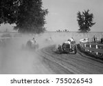 Racecars rounding a turn at the ...