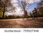 family time  riding bicycle in... | Shutterstock . vector #755027548