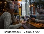 young couple using mobile phone ... | Shutterstock . vector #755035720