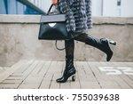 stylish woman walking in city... | Shutterstock . vector #755039638