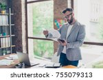 focused concentrated accountant ... | Shutterstock . vector #755079313