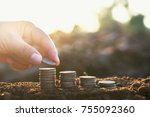 hand putting coins stack on... | Shutterstock . vector #755092360