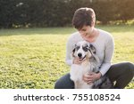 beautiful woman and her dog... | Shutterstock . vector #755108524