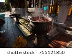 Small photo of Incense sticks in pots to hallow of Wat Phra That Lampang Luang in Thailand