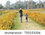 mom and child in the park  | Shutterstock . vector #755153206
