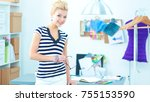 young fashion designer working... | Shutterstock . vector #755153590