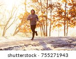 Man Jogging Outdoors On Cold...