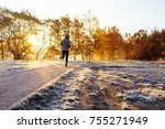 man out on jog in park durig... | Shutterstock . vector #755271949