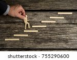 businessman climbing the steps... | Shutterstock . vector #755290600