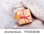 women is holding a small gift... | Shutterstock . vector #755303038
