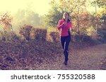 beautiful young woman running... | Shutterstock . vector #755320588