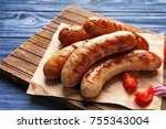 Grilled Sausages On Wooden Board