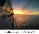 View from the bridge to the stern of the ship during a stunning sunrise somewhere on the Atlantic