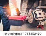 The abstract image of the back of technician hold a toolbox and blurred disc brake is backdrop. the concept of automotive, repairing, mechanical, vehicle and technology. - stock photo