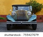Old American Car On Cobbled...