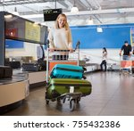 young woman with luggage in... | Shutterstock . vector #755432386