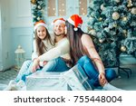 christmas photo of surprised... | Shutterstock . vector #755448004