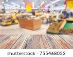 wood table over supermarket... | Shutterstock . vector #755468023
