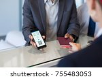 Small photo of Closeup hand of man showing flight ticket to staff on phone. Hostess checking electronic flight ticket. Airport check in counter and online air ticket.