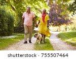 senior couple walking with pet... | Shutterstock . vector #755507464